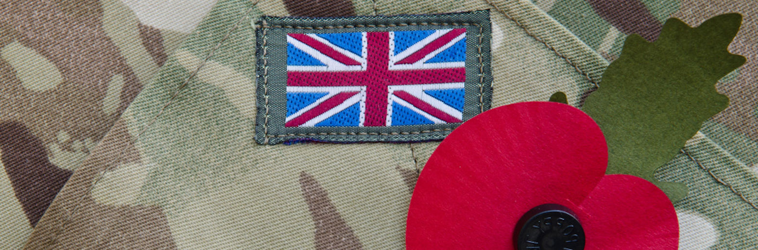 Photo of a member of the Armed Forces uniform with a poppy pinned to it
