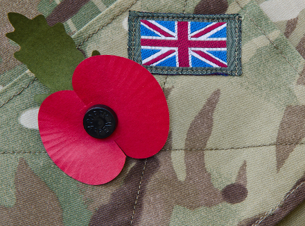 Photo of a member of the Armed Forces' uniform with a poppy pinned to it