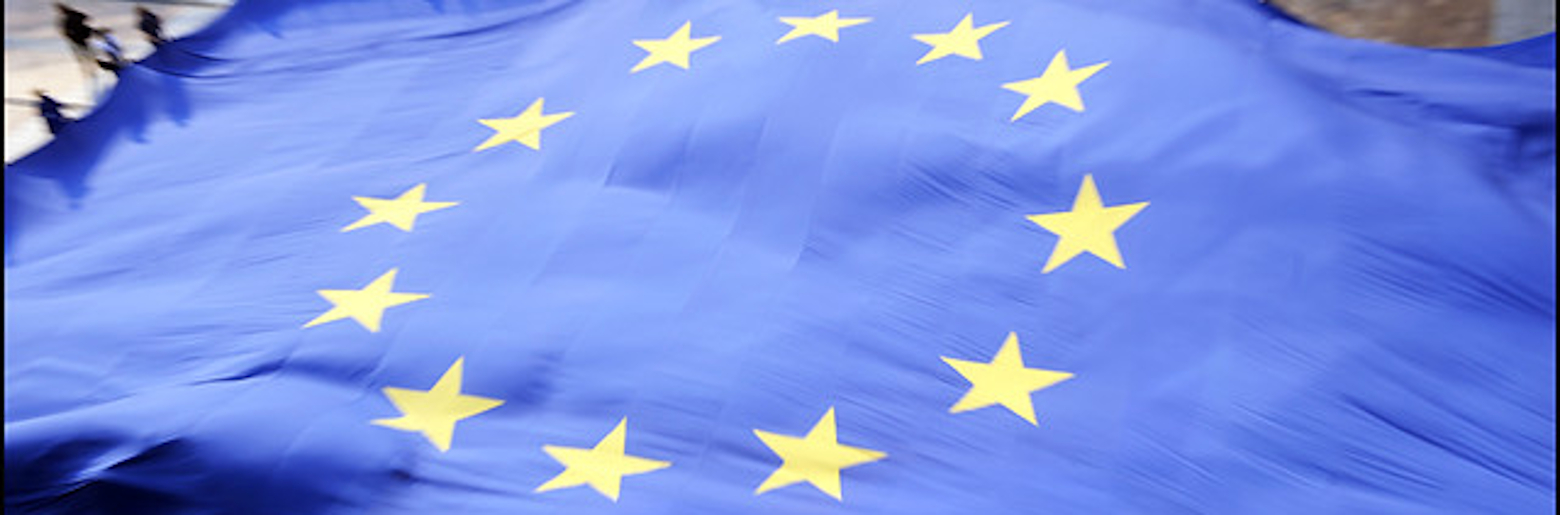 Photo of the European Union (EU) flag being held open by people