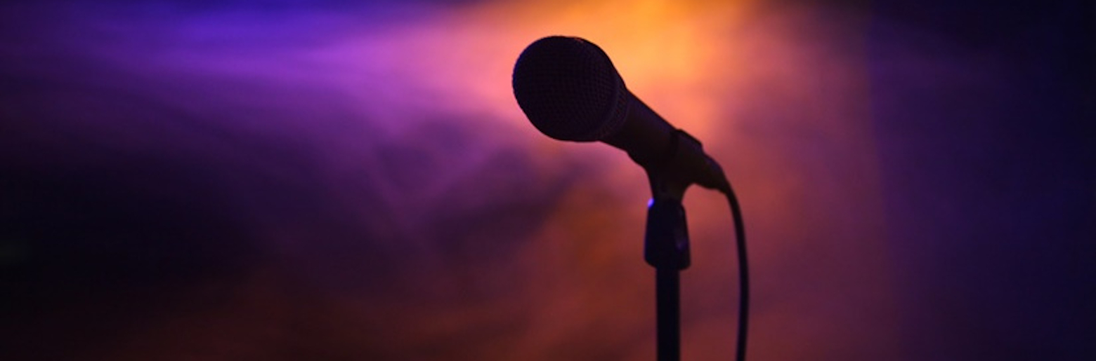 A photo of a microphone on stage