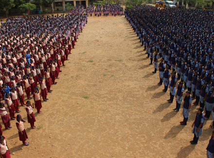 School students stand in lines in India