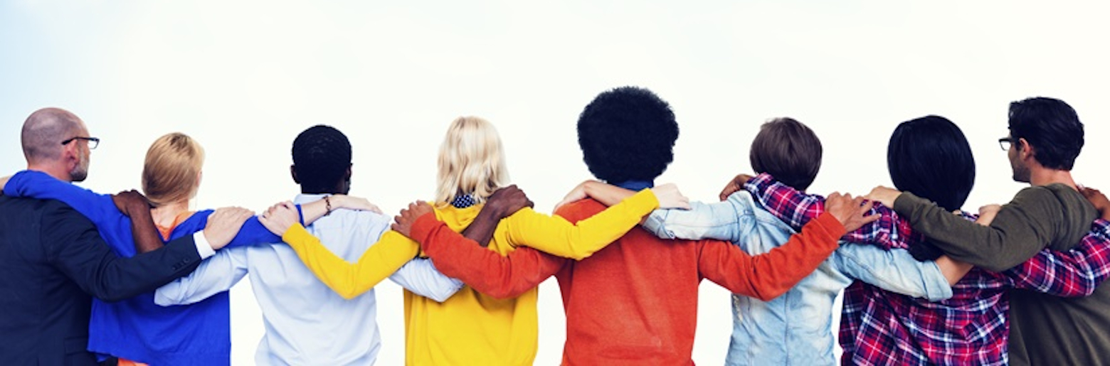 Photo of a group of people with their arms around each other, stood in a line