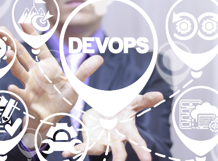 Image of a person holding DevOps to illustrate the methodology