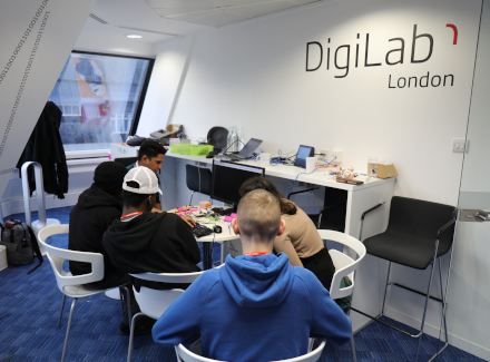 Sopra Steria employees teaching young people digital skills