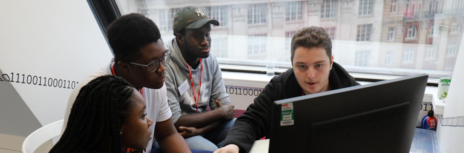 Sopra Steria employees teaching young people digital skills