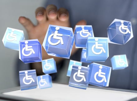 Graphic of a hand over a holographic image of cubes with the International Symbol of Access (ISA), also known as the (International) Wheelchair Symbol, on them