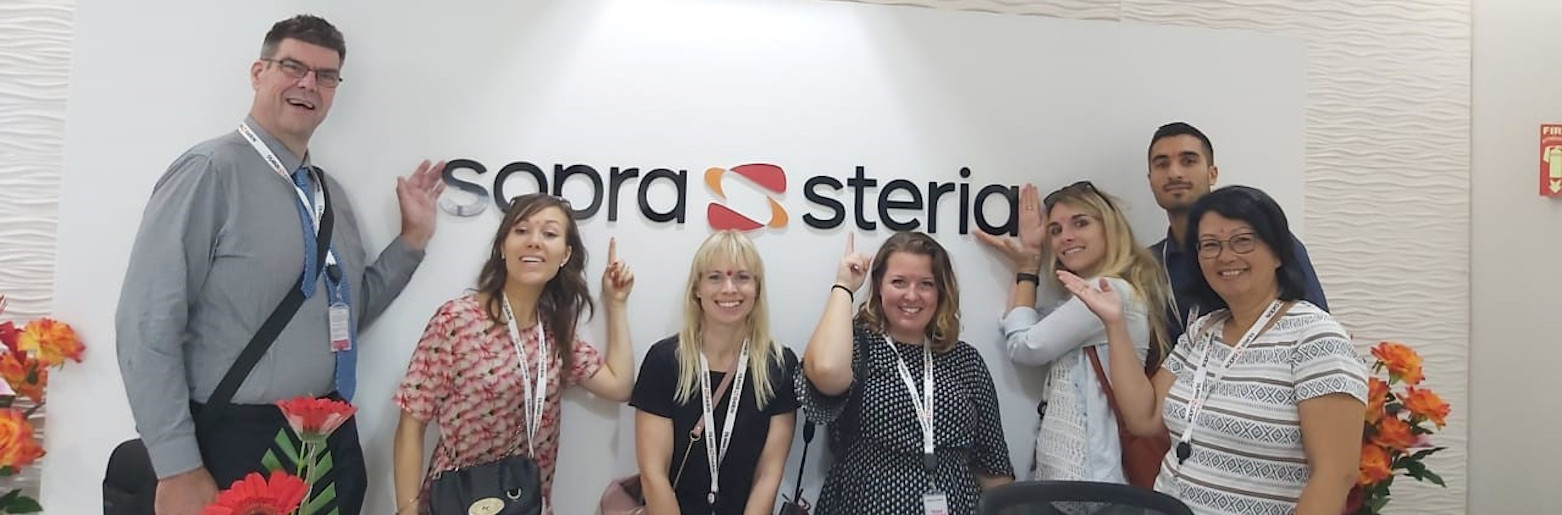 Volunteers at a Sopra Steria office in India on their first day there
