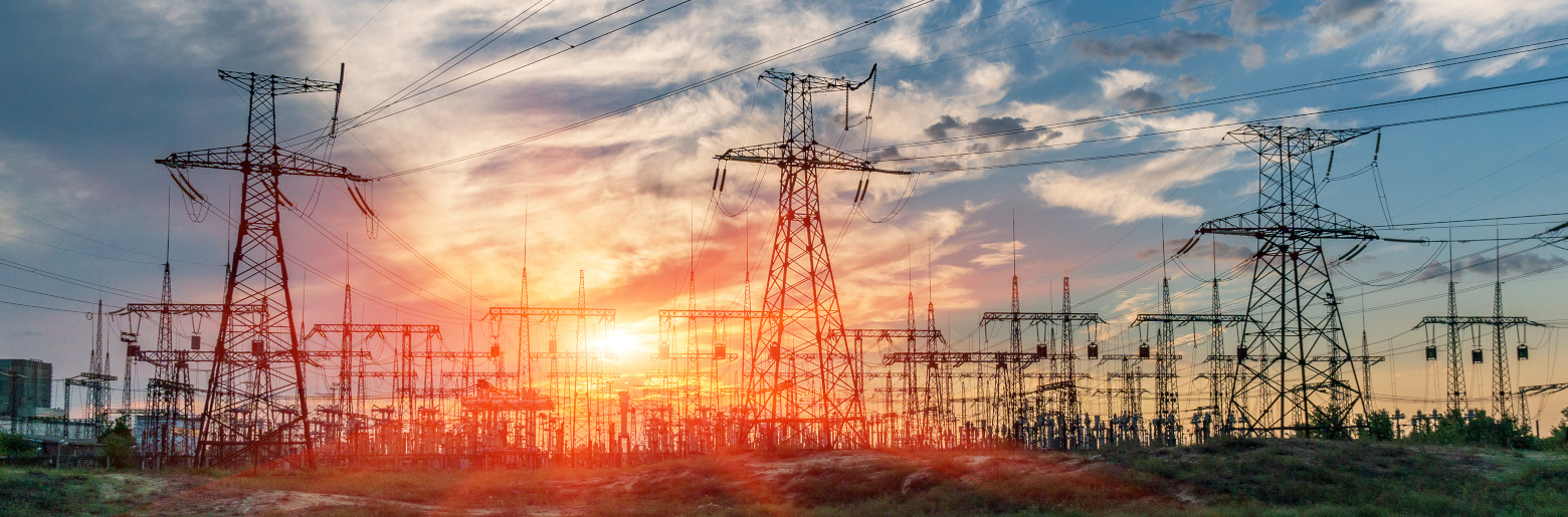 Photo of an electric substation with power lines and transformers